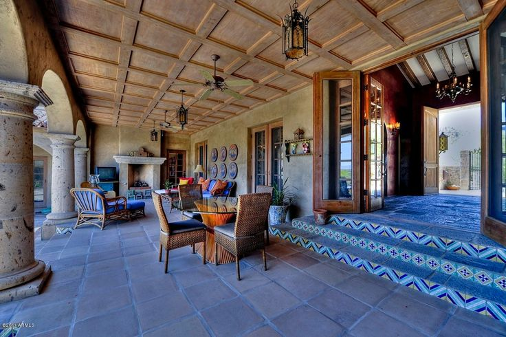 Southwestern Porch with outdoor pizza oven, Wrap around porch, exterior tile floors, exterior terracotta tile floors