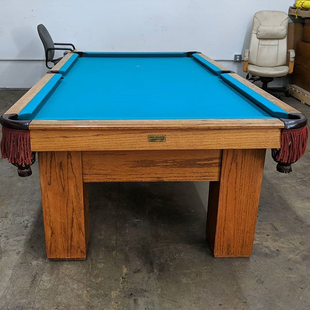 USmilcom in Santa Ana is the place to work. The boss is giving them an 8-foot Regal pool table to play with during break time.