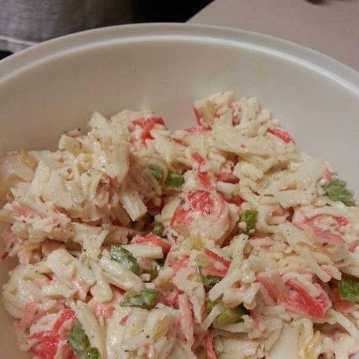 Mr. Crab's Salad Recipe with imitation crab meat, butter, black pepper, parsley, mayonnaise, old bay seasoning, celery salt, paprika, celery ribs, onions