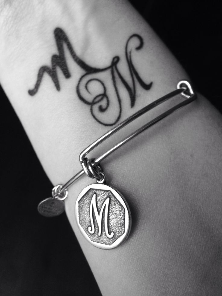 Charmed arm. MM tattoo. Alex and Ani M charm. Wrist tattoo.  #charmedarms #alexandani