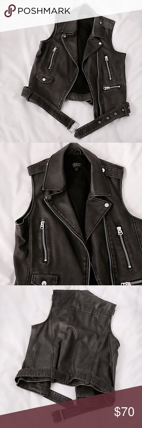 """Topshop 'Sylvia' Vegan Leather Biker Vest Faded black vegan leather biker vest by Topshop. Features 3 zip pockets to front, detachable belt, boxy fit, and silver hardware. Diagonal zip front. Marked size US8, equivalent to a size Medium and great for smaller sizes as well if you want a boxy fit. Worn twice and in perfect condition. 24""""L, 19"""" pit to pit. Retail $90. Topshop Jackets & Coats Vests"""