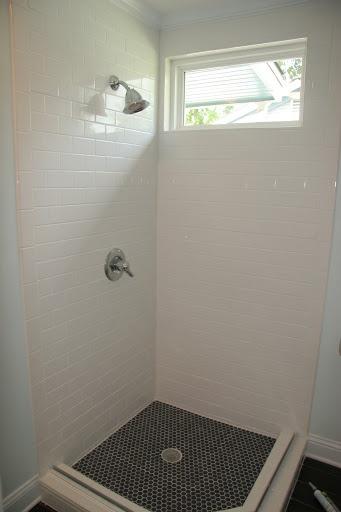 Elmwood Bath White Subway Tile With Black Hexagon Floor