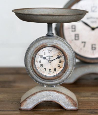 "This adorable scale shaped clock is perfect for your farmhouse kitchen! Looks great with industrial and modern country decor too! Stands 9.5"""" high. Scale pan is 7.75"""" in diameter and clock is approx"