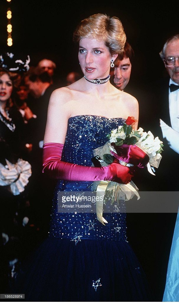 Diana, Princess of Wales, wearing a navy blue Murray Arbeid dress and shocking pink long gloves, attends 'Phantom of the Opera' on February 01, 1987 in London, England.