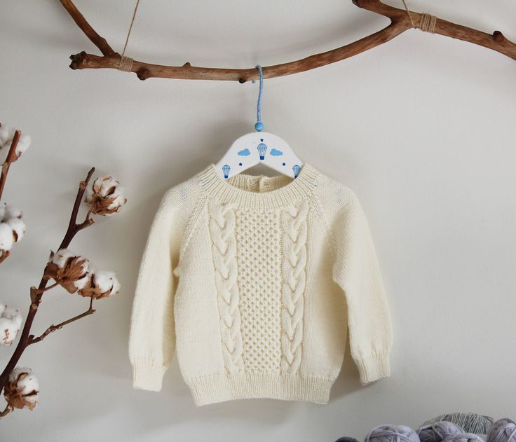 Baby knit sweater This cable knit sweater will give a stylish look to your little one and at the same time will keep him or her warm and comfortable. It is light and breathable. The sweater is crafted from 100% natural baby merino, a super soft and itch-free wool yarn, that is perfectly