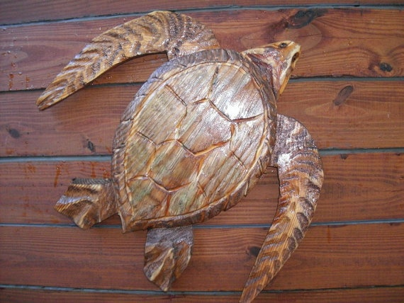 Sea turtle chainsaw wood reptile carving by