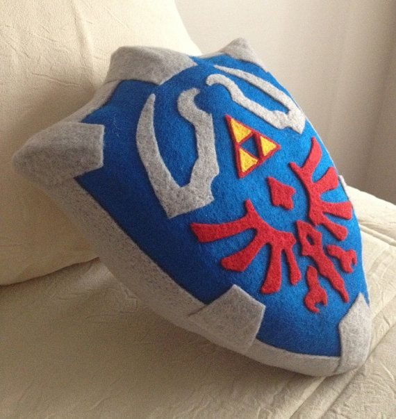Legend of Zelda Shield Pillow- This is amazing, but it's expensive. Maybe I could make this...
