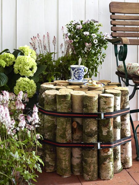 diy garden furniture - CUT armful of logs to the same length