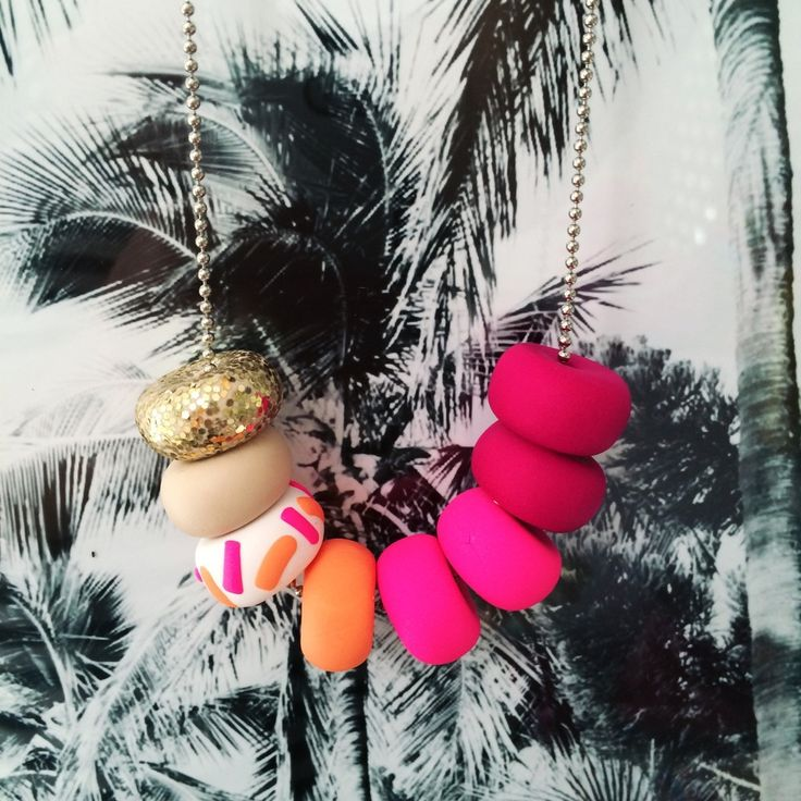 Hibiscus - Shades of Hot Pinks   Bright Peaches Coast - Shades of calming Sea greens   Pastel PeachMarina - Shades of Navy   Cognac   NeutralsAll strung onto a silver steel ball chain and hangs approx just below or on the bust line.