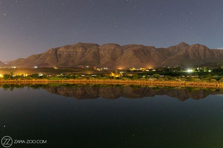 Night photo of the Stellenbosch mountains at Cavalli Estate.
