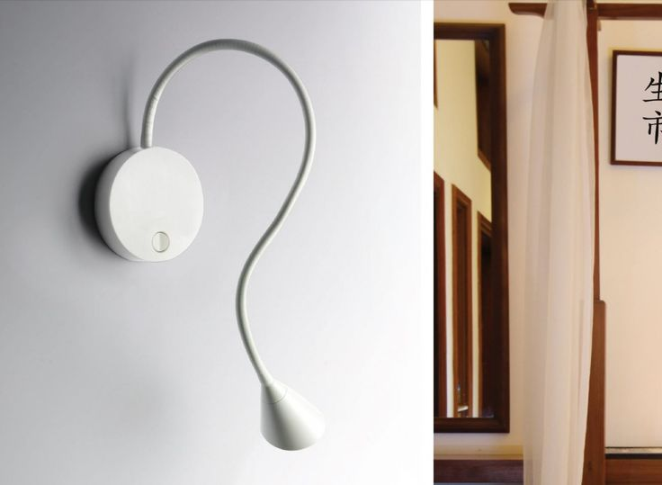 Adjustable wall lamp with converter and switch included.