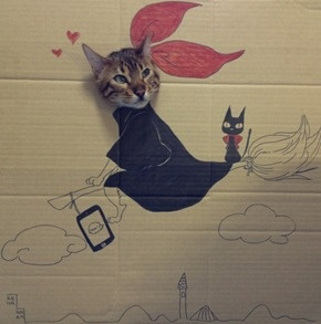 Kiki's Delivery Service! A Chinese blogger with the user name toshiya86 created several hand-illustrated cardboard character costumes for her cat, Guagua. All Guagua has to do is stick his head through the hole and be photographed. Brilliant. You can see all of the photos at Chick Geek Games.