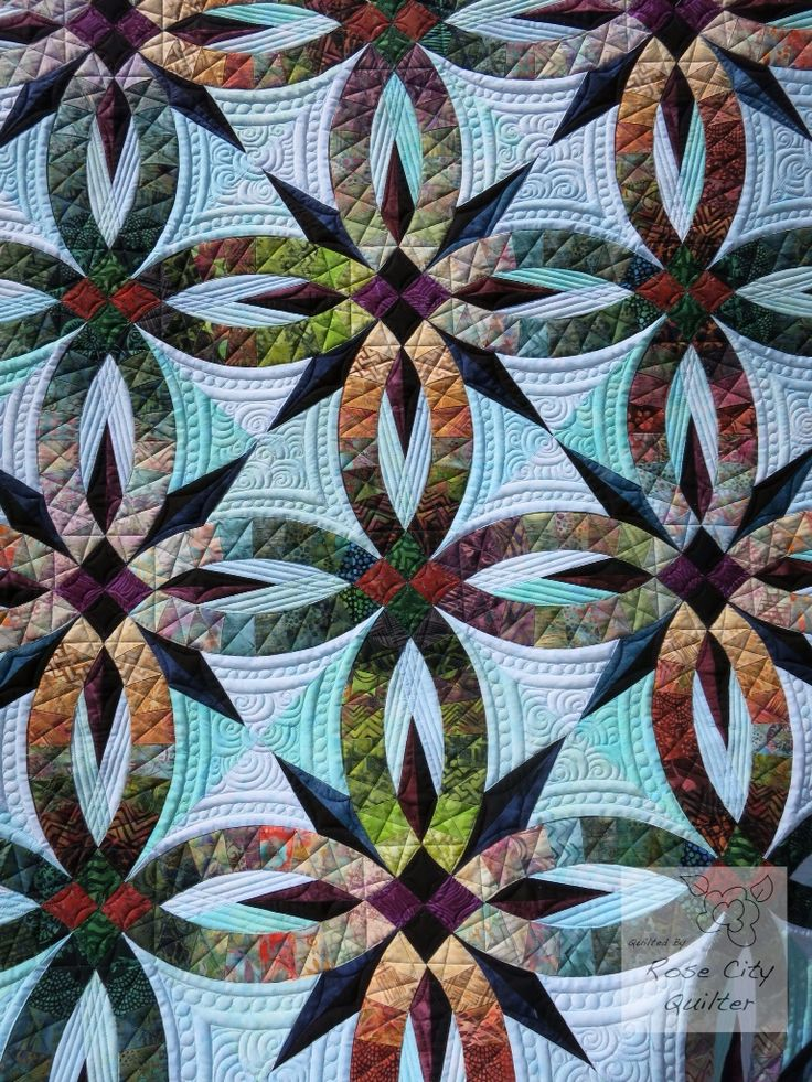 Bali Wedding Star quilt, quilted by Rose City Quilter. Pattern by Judy Niemeyer.