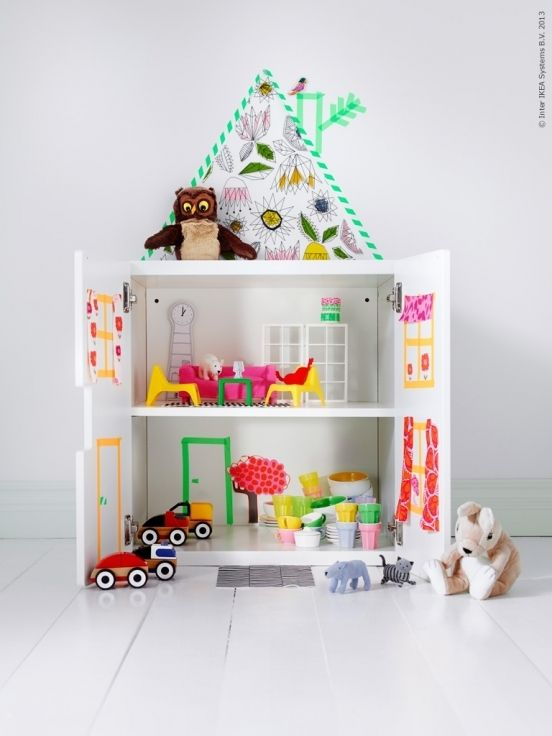 This is a Stuva cabinet with doors that has easily and quickly been transformed into another charming dolls house. The washi tape roof completes this dolls house with little effort but lots of imagination.