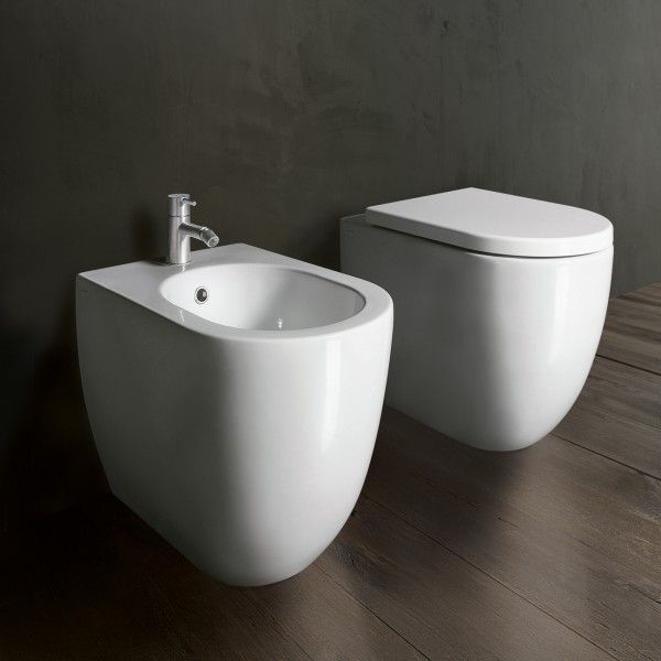 Designed by Catalano, the C Series C52 Floor Mount Toilet is a compact, contemporary toilet solution characterised by its soft morphological design and circular form. The C52 Floor Mount Toilet is further complemented by the C52 Floor Mount Bidet and the Catalano collection of basins, offering a complete bathroom. Please note this package comes with pan, standard seat and 4.5L in wall cistern. All that is required is your choice of button.