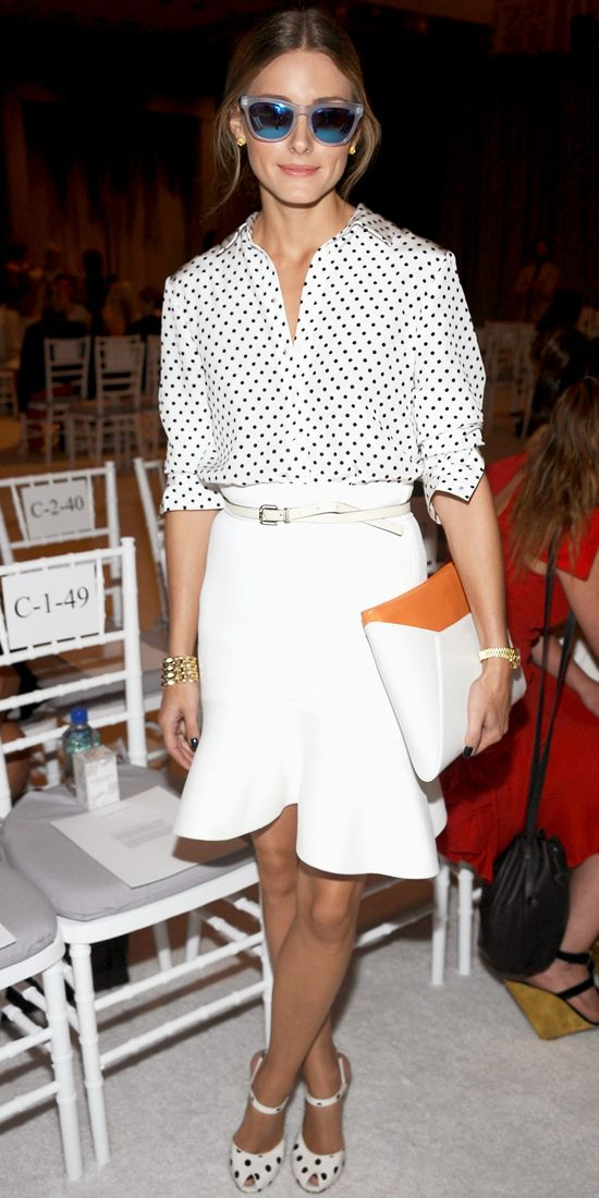 Olivia Palermo was front row at Marchesa's spring 2014 runway show in a polka dot Tibi shirt and a Scanlan & Theodore white skirt. Westward Leaning sunnies, polka dot peep-toes and a Smythson iPad clutch finished the look.