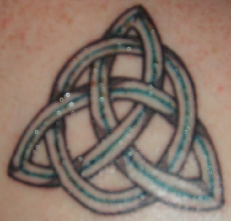 "My second tattoo done in honour of my 45th birthday by Gordon, a good friend of mine.  This is a Celtic triquetra which represents ""the Father, Son and the Holy Spirit"" and honours my English/Scottish heritage."