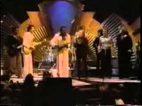 """This is from April 1977, """"The Midnight Special"""" ABC with host George Benson. He's on stage with Van Morrison, Dr. John, Santana and Etta James."""