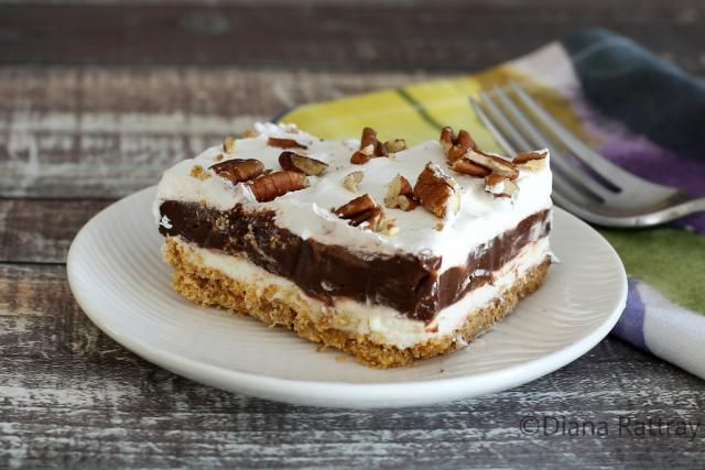 A very popular recipe for chocolate delight made wth layers of pudding, sweetened cream cheese, and whipped topping on a graham cracker crust'
