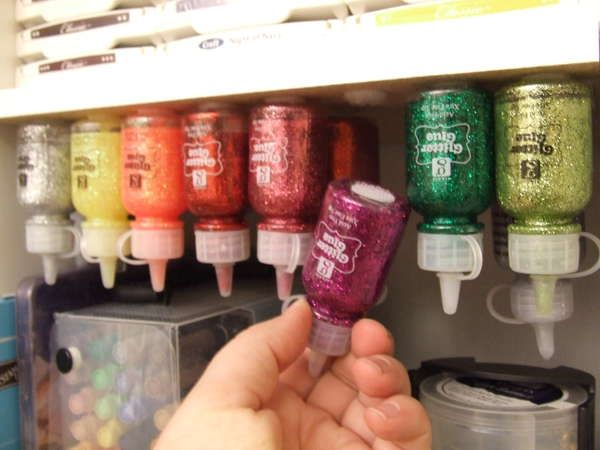 glitter glue storage - genius!  This would work well for other sewing room items as well