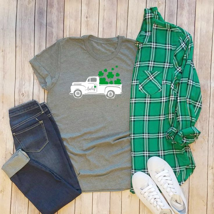 Ready for St. Paddy's Day in style! Here's our Shamrock in our favorite Buffalo Print. What a perfect layering tee to go with any flannel, sweater, cardigan or even alone! Be on trend and no worrying about getting pinched! These Tees are so soft and comfy! Just pair these with your favorite skinny jeans, leggings, even a skirt and you've got a perfect outfit! A rolled up sleeve is super cute too! Fabric Content: Soft cotton/poly blend Bella Canvas t-shirts are 4.2 oz. 100% co...