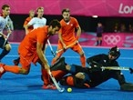 Valentin Verga of Netherlands shoots at the goal of James Fair of Great Britain
