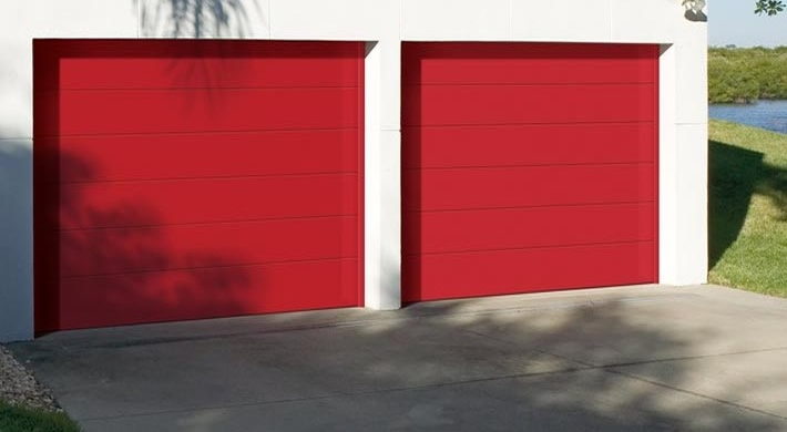 Close up of cherry red flush panel garage door flush for Flush panel wood garage door