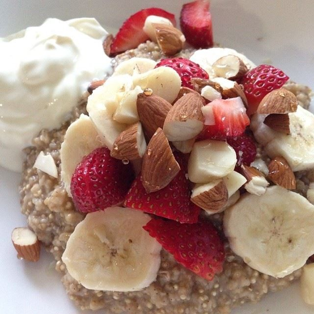 Quinoa, oat and chia porridge topped with strawberries, banana, almonds, natural yoghurt & honey!