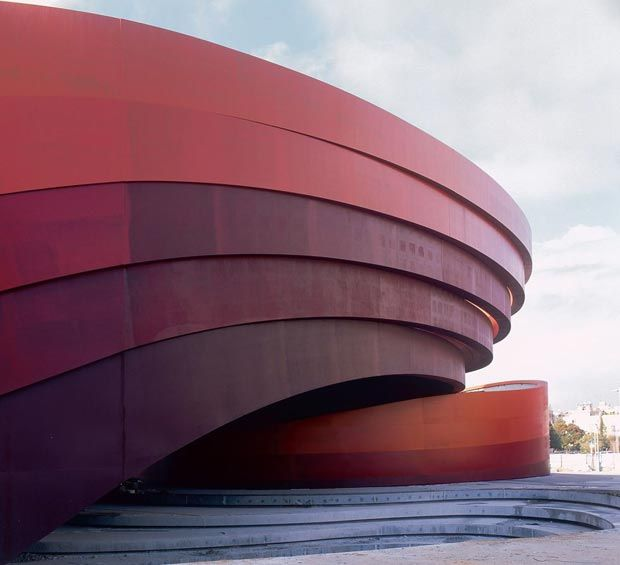 Design Museum in Holon, Israel conceived by the great architect Ron Arad. The five gradient steel bands clearly separated on the façade are actually part of the structure, ondulating and meandering together or separated like a visual thread running through the museum.