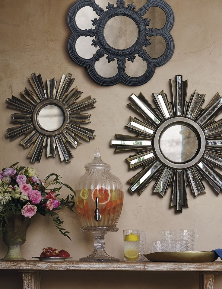 The glamour of art deco design makes its way outdoors. Create your own masterpiece with these aluminum mirrors, with faux gilded panels embedded in each ray that reflect light from every direction.