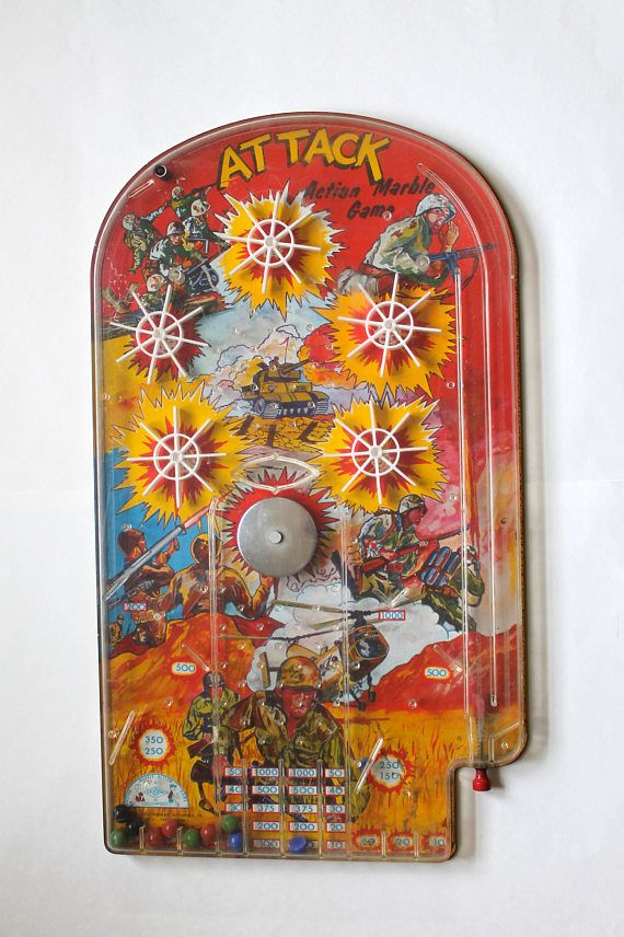 Up for sale is a Vintage 1970s JUMBO Wolverine Toys Attack Action Marble Game Tin Litho Pinball! RARE! 23 Tall! Condition: Game does show some wear from age and use and has one broken marble inside as seen in photos. Works. Measures approx: 23 long by 13.5 Wide. Please ask any