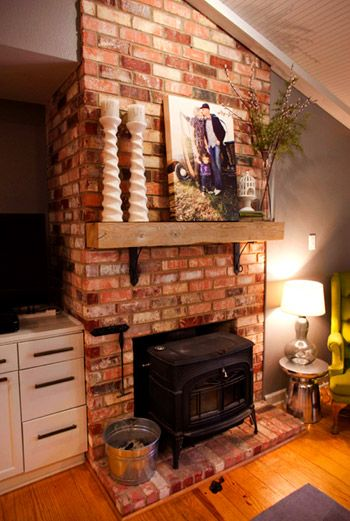 love this rustic mantle. and exposed brick.
