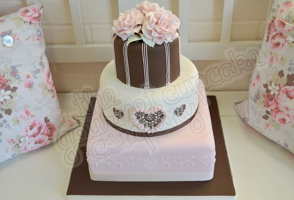 Love this pretty pink cake from The Gourmet Cupcake Company