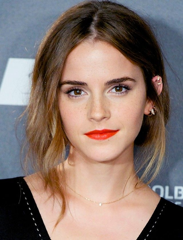 Emma Watson pairs her new haircut with a bold red lip