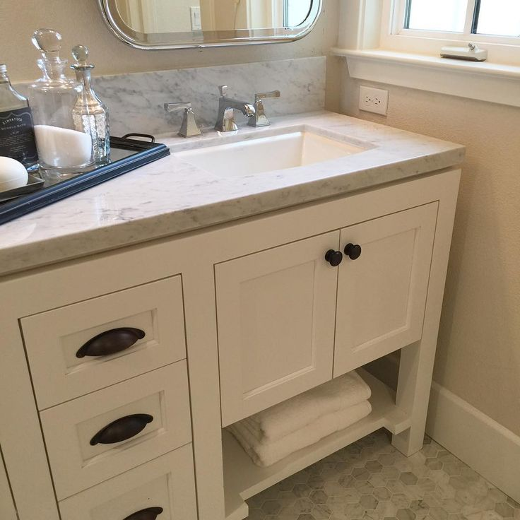 Simple and timeless master bathroom at Robson Homes' new community, Madison, in the charming town of Campbell. #bathroom #bathdesign #bathroomdecor #modelhome #interiordesign #timeless #transitional #classic #elegant #marble #limestone #whitecabinets #bronzehardware @robson_homes #campbell #california #siliconvalley #newhomes