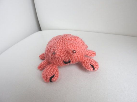 Hand knitted super cute Crab critter? Mind you, you might want to keep your fingers to yourself - he has a tendancy to nip them.