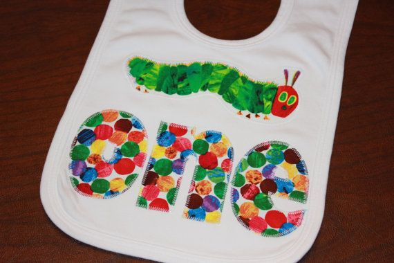 This 100% cotton 1 or 2 layer knit bib is adorable with the Very Hungry Caterpillar and One applique. The bib has velcro closure. The Bib is 8.25