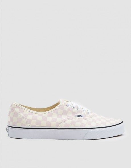 Classic Authentic sneaker from Vans in Chalk Pink. Signature checkerboard  canvas upper. Lace-up front with flat woven laces. Tonal eyelets. a424383283fd
