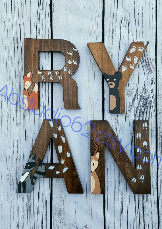 The price of the listing is for INDIVIDUAL LETTERS. When ordering please select the quantity of letters in the NAME, then include the name in the note to seller section of the checkout page.  Natural Pine 8 Wooden letters, in Helvetica font, which are hand stained on all sides with a Walnut Stain. Then, a woodland creature and its tracks are hand painted on each letter. 12 VERSION NOW AVAILABLE--> https://www.etsy.com/listing/513170743/wooden-letters-for-nursery-wo...