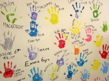 """Birthday Party Hand Prints--I could do this for the """"5th"""" birthday...all the guests could leave their handprint to wish the birthday girl well!"""