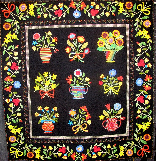 Gorgeous flower patterned quilt!