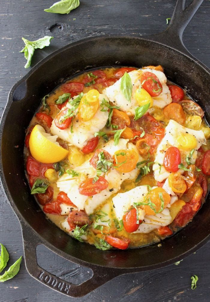 Pan Seared Halibut Fillets in Garlic White Wine Sauce with Heirloom Tomatoes and Basil  in a Cast Iron Skillet | CiaoFlorentina.com @CiaoFlorentina