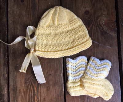 Vintage Hand Knitted Yellow Bonnet And Booties Set 10.00 Lovely vintage hand knitted booties and bonnet set in yellow. The booties have a white stripped scalloped edge detail and the bonnet fastens with a yellow ribbon.  Size Newborn  Coordinate with some of our childrens accessories