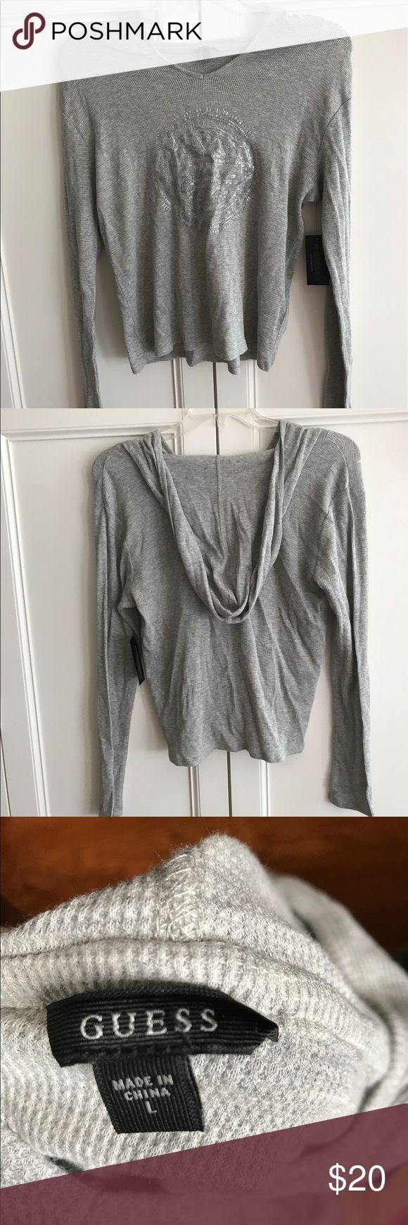 Guess hoodie Grey and silver hoodie never worn with tags Guess Sweaters