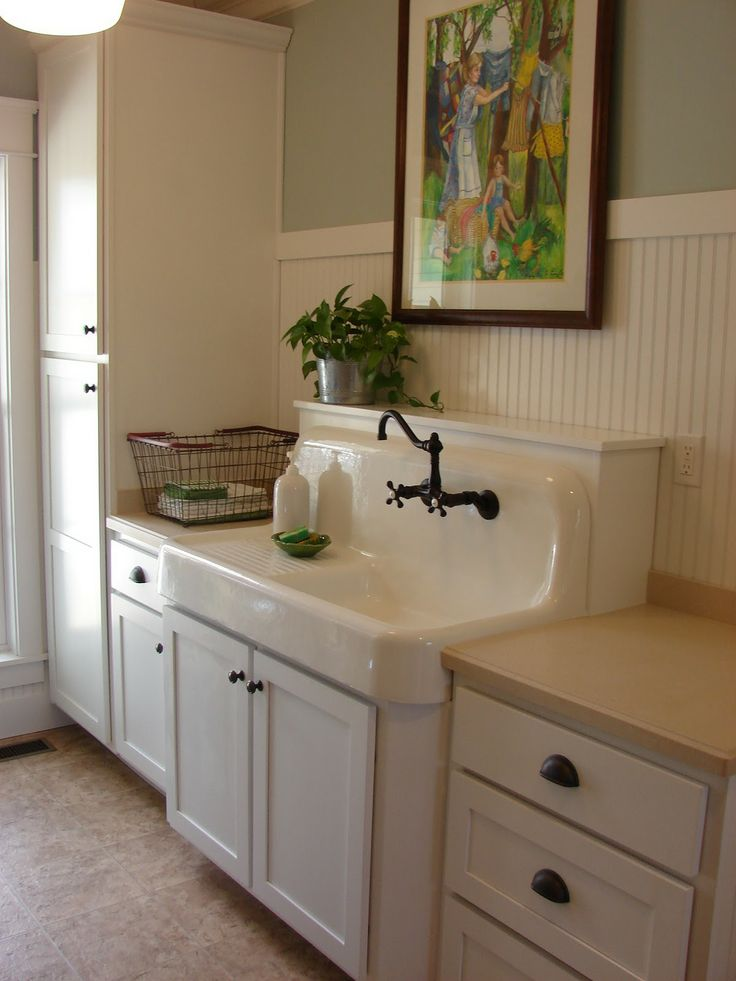 This is a solution if your vintage sink is more narrow than your base cabinets.  They built a type of shelf behind the back of the sink.  Perfect!!!