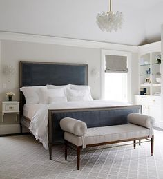 Gray bedroom with blue velvet headboard..normally I hate the idea of a blue velvet/navy blue headboard...but this works really, really nicely!