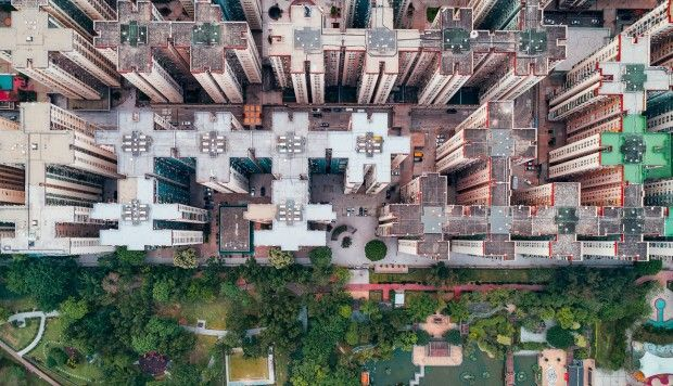 A bird's-eye view of Hong Kong's crowded high-rises in local photographer's Walled City series Andy Yeung uses a drone to highlight today's overcrowded residential estates that he says remind him of Kowloon's infamous Walled City, which he saw demolished when a child