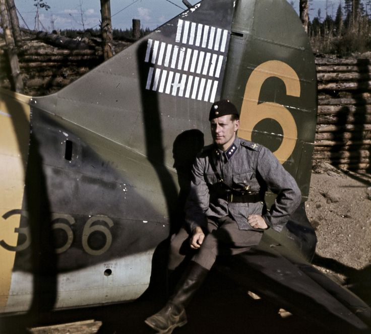 Finnish pilot Jorma Karhunen from his fighter Brewster B-239 at the airport Suulayarvi