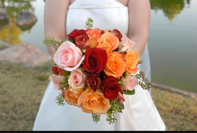 This was my wedding bouquet by Phoenix Flower Shops, Oct. 31, 2008. I chose ten to twelve shades of roses in autumn colors, which they complemented with coffee-bean accents. I found the combination refreshing and different. Photo by Deb Wolfe.