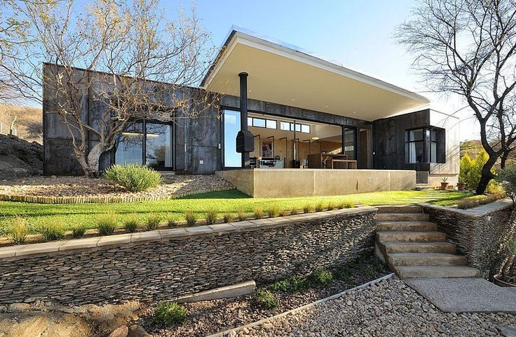 Hard-landscaped terrace - House in Namibia by Wasserfall Munting Architects | HomeAdore